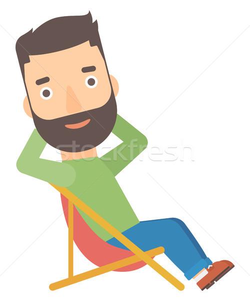 Man sitting in a folding chair. Stock photo © RAStudio