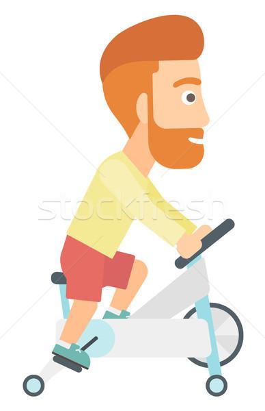 Adam bisiklete binme egzersiz sakal egzersiz Stok fotoğraf © RAStudio