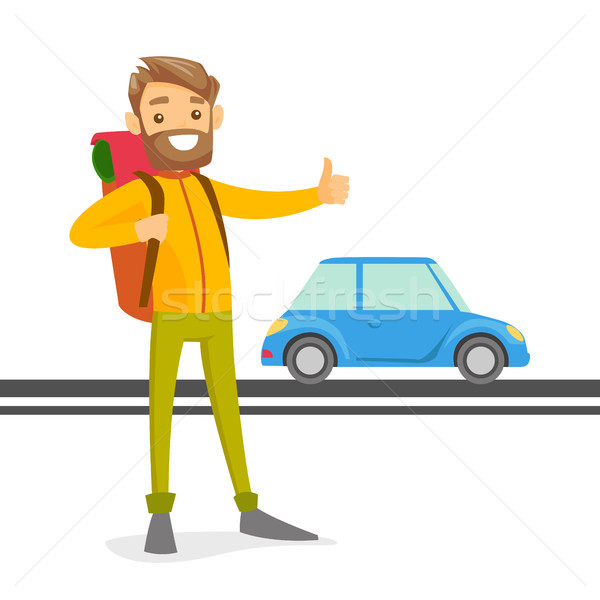 Young caucasian white man trying to stop a taxi. Stock photo © RAStudio