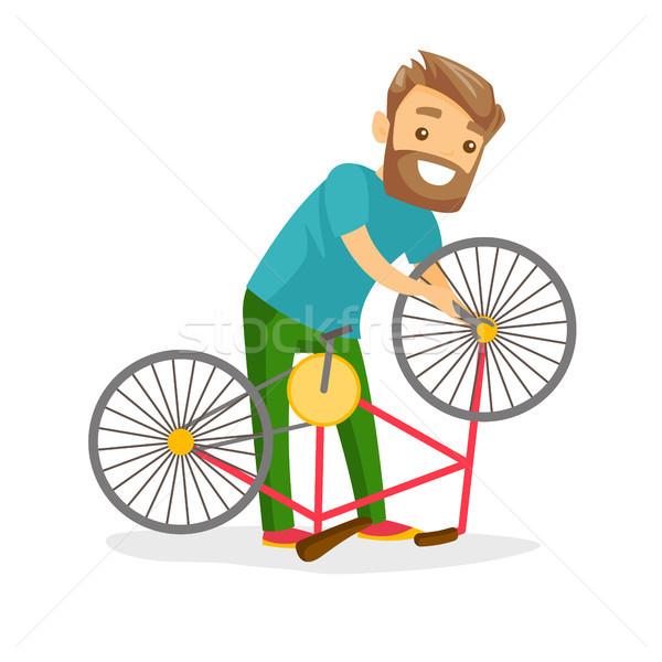 Kafkas beyaz adam çalışma bisiklet atölye Stok fotoğraf © RAStudio