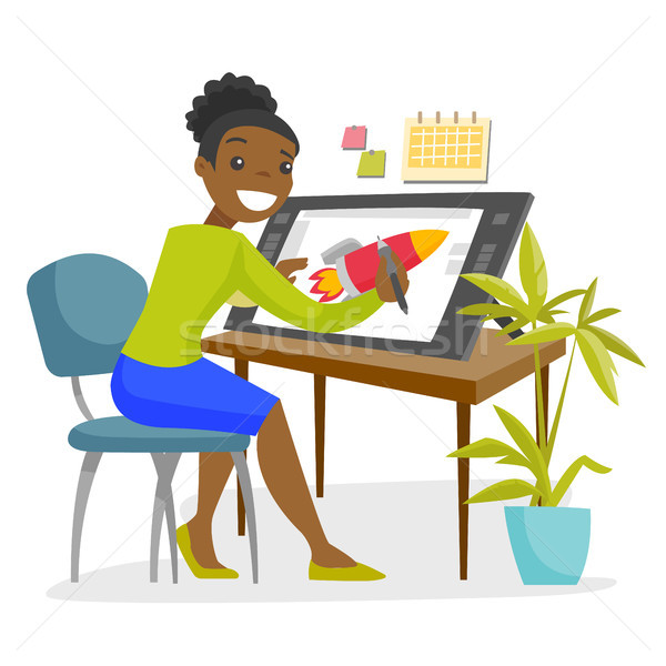 A black woman graphic designer works at the office desk. Stock photo © RAStudio