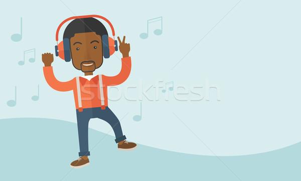Stock fotó: Boldog · fiatalember · tánc · zenét · hallgat · fekete · énekel
