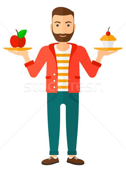 Homem maçã bolo mãos escolha saudável Foto stock © RAStudio
