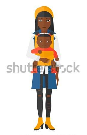 Woman holding baby in sling. Stock photo © RAStudio