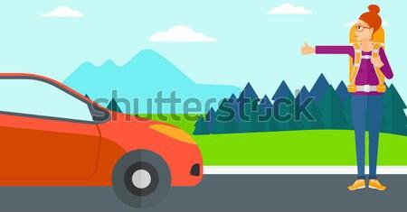 Young woman hitchhiking. Stock photo © RAStudio