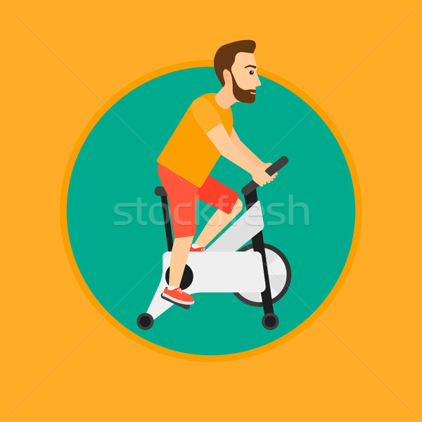 Man riding stationary bicycle. Stock photo © RAStudio