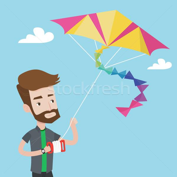Young man flying kite vector illustration. Stock photo © RAStudio