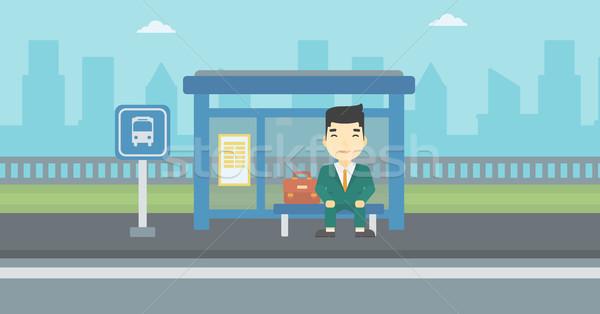 Man waiting for bus at the bus stop. Stock photo © RAStudio