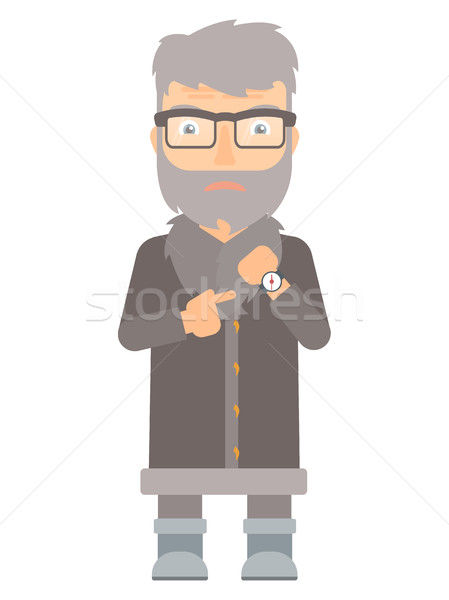 Angry north man pointing at wrist watch. Stock photo © RAStudio