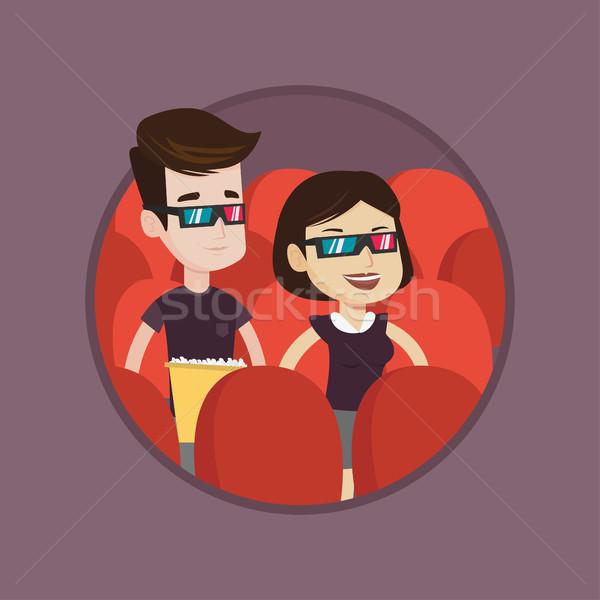 Happy couple watching 3D movie in the theatre. Stock photo © RAStudio