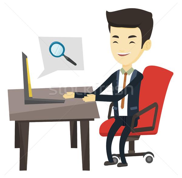 Business man searching information on internet. Stock photo © RAStudio