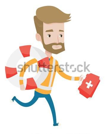 Paramédico corrida primeiro socorro caixa jovem asiático Foto stock © RAStudio