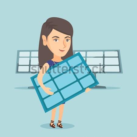 Vrouw zonnepaneel asian werknemer Stockfoto © RAStudio