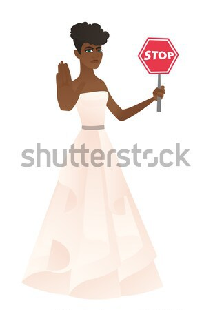 Asian fiancee holding stop road sign. Stock photo © RAStudio