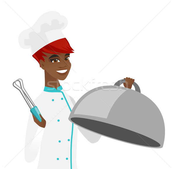 African chef cooking chicken on barbecue grill. Stock photo © RAStudio