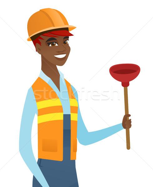 African-american plumber holding plunger. Stock photo © RAStudio