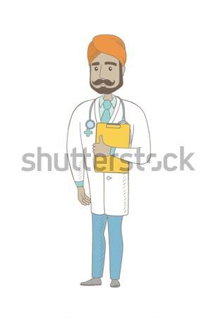 Young indian doctor examining a radiograph. Stock photo © RAStudio