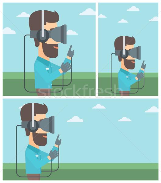 Adam sanal gerçeklik kulaklık oynama video oyunu Stok fotoğraf © RAStudio
