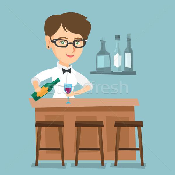 Caucasian bartender standing at the bar counter. Stock photo © RAStudio