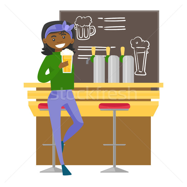 African-american woman drinking beer at the bar. Stock photo © RAStudio