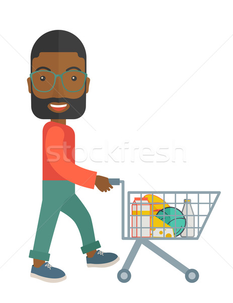 Black Male Shopper Pushing a Shopping Cart. Stock photo © RAStudio