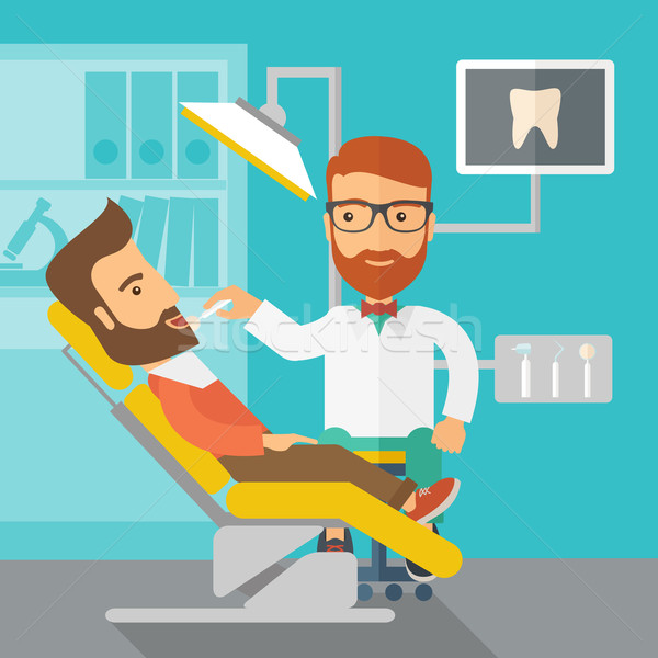 Dentist man examines a patient teeth in the clinic Stock photo © RAStudio