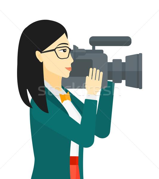 Cameraman with video camera. Stock photo © RAStudio