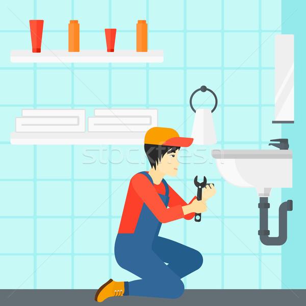 Man repairing sink. Stock photo © RAStudio