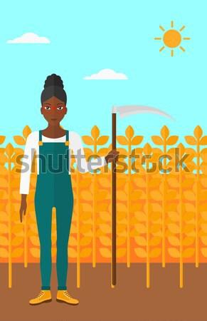 Farmer on the field with scythe. Stock photo © RAStudio
