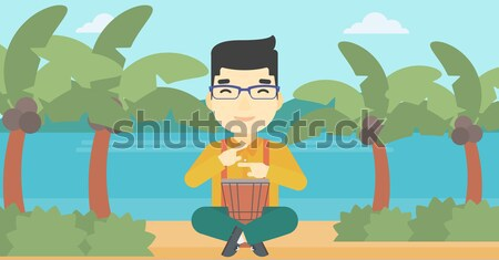 Man with rake standing near heap of autumn leaves. Stock photo © RAStudio