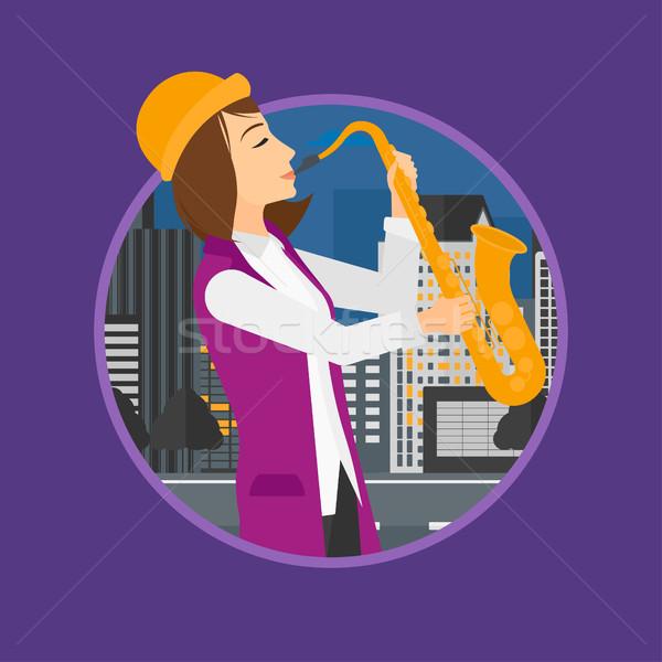Kobieta gry saksofon muzyk noc młoda kobieta Zdjęcia stock © RAStudio