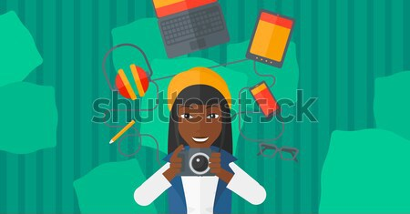 Young woman surrounded with her gadgets. Stock photo © RAStudio