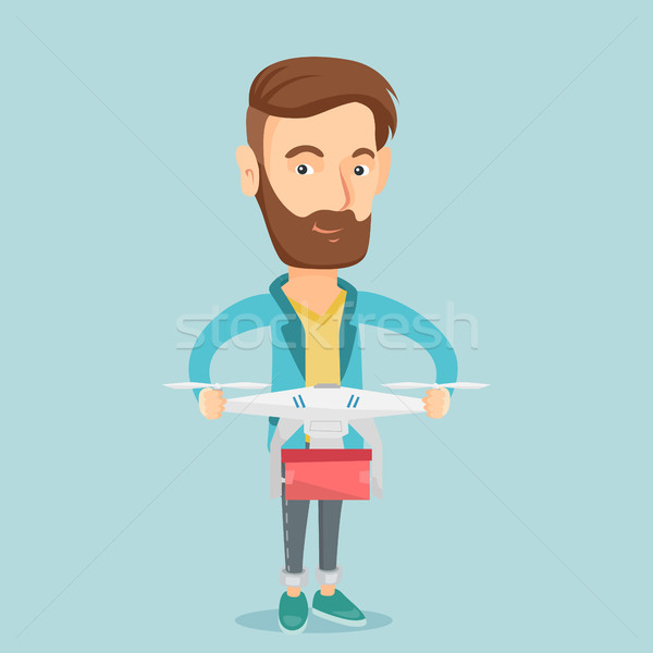 Man controlling delivery drone with post package Stock photo © RAStudio