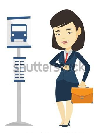 Mulher espera parada de ônibus asiático mulher de negócios pasta Foto stock © RAStudio