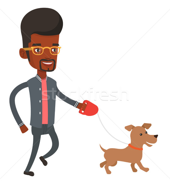 Joven caminando perro mascota feliz hombre Foto stock © RAStudio
