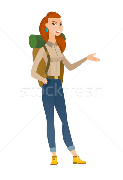 Traveler with arm out in a welcoming gesture. Stock photo © RAStudio