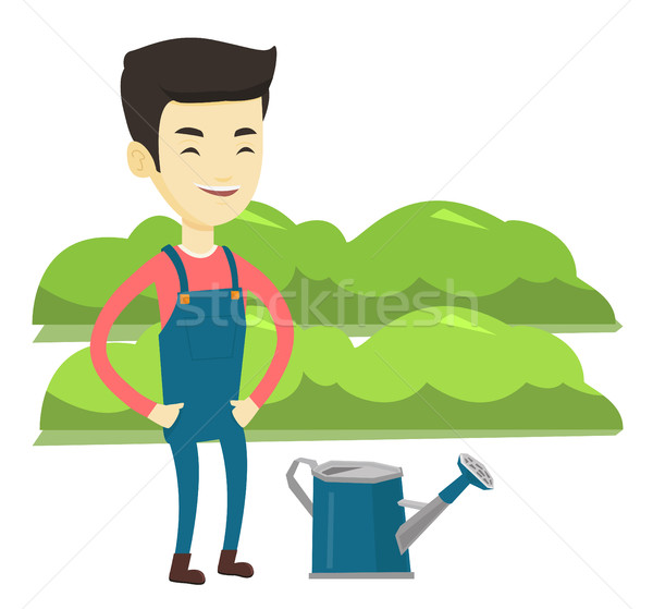 Farmer with watering can at field. Stock photo © RAStudio