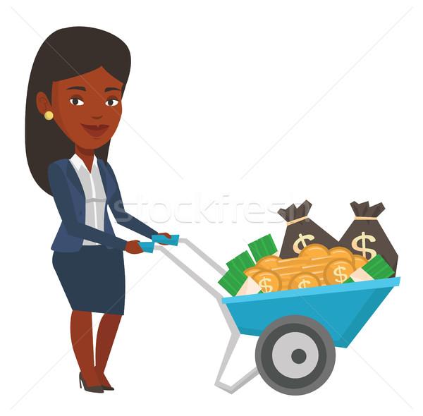 Businesswoman depositing money in bank in the safe Stock photo © RAStudio