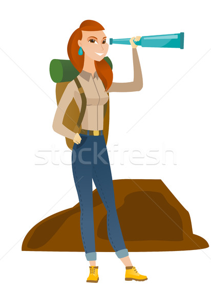 Young caucasian traveler with spyglass. Stock photo © RAStudio