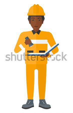 African-american builder singing to the microphone Stock photo © RAStudio