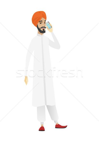 Businessman talking on a mobile phone. Stock photo © RAStudio