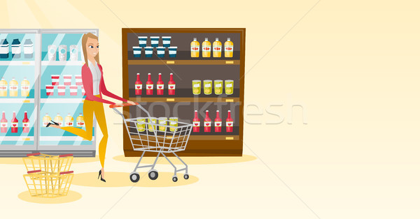 Caucasian woman running with trolley in the store. Stock photo © RAStudio