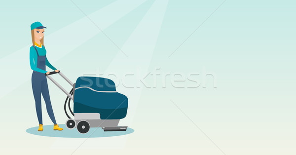 Woman cleaning the store floor with a machine. Stock photo © RAStudio