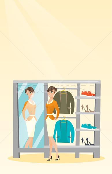 Caucásico mujer chaqueta vestidor jóvenes mirando Foto stock © RAStudio