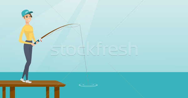 Young caucasian woman fishing on jetty. Stock photo © RAStudio