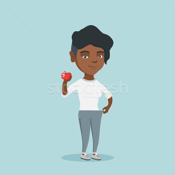 Slank vrouw pants tonen resultaten dieet Stockfoto © RAStudio
