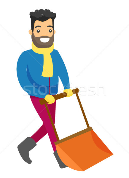 Man shoveling snow with a big spade in the winter. Stock photo © RAStudio