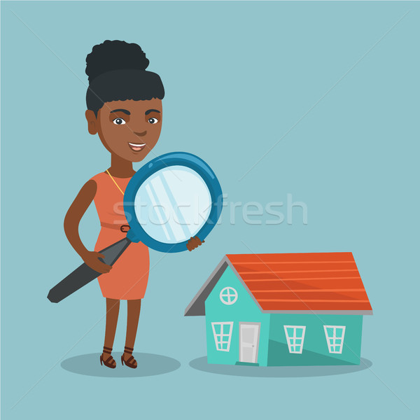 Young african business woman looking for a house. Stock photo © RAStudio