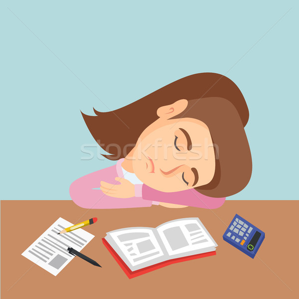 Young caucasian student sleeping on the desk. Stock photo © RAStudio