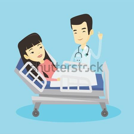 Сток-фото: врач · пациент · азиатских · указывая · пальца · вверх